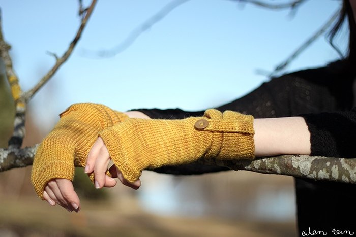 fingerless gloves knit in mustard coloured yarn
