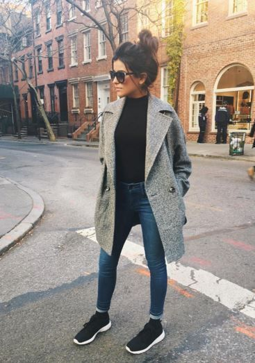 woman wearing a grey tailored coat in fall