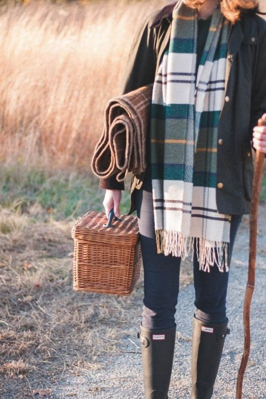 woman wearing a barbour coat and plaid scarf for a picnic