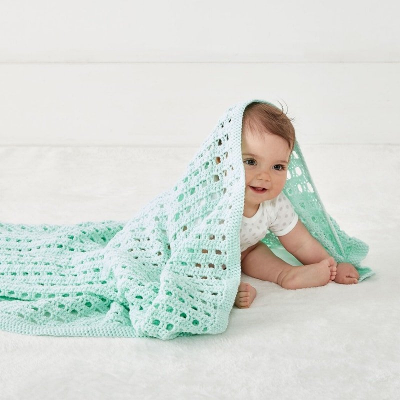 baby with a crochet blanket