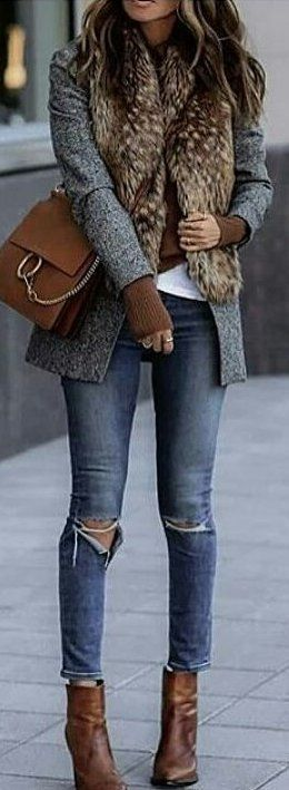 woman wearing a fitted blazer over jeans in fall
