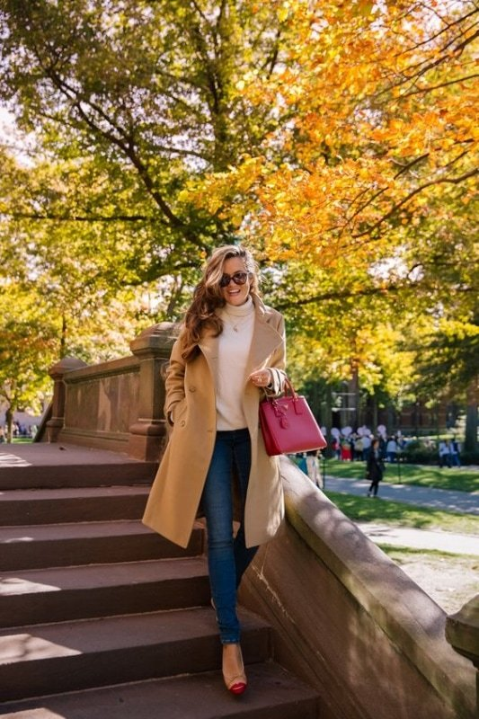 woman wearing a camel coat outfit in fall