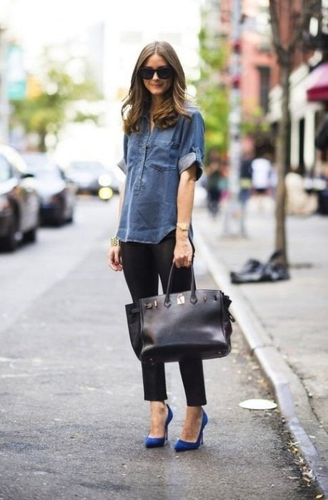 woman with a large black leather tote bag