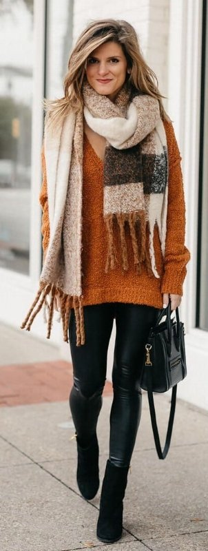 woman wearing a large brown knitted scarf