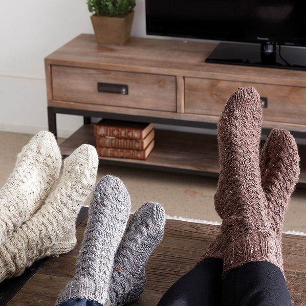 Cable knit socks in three sizes