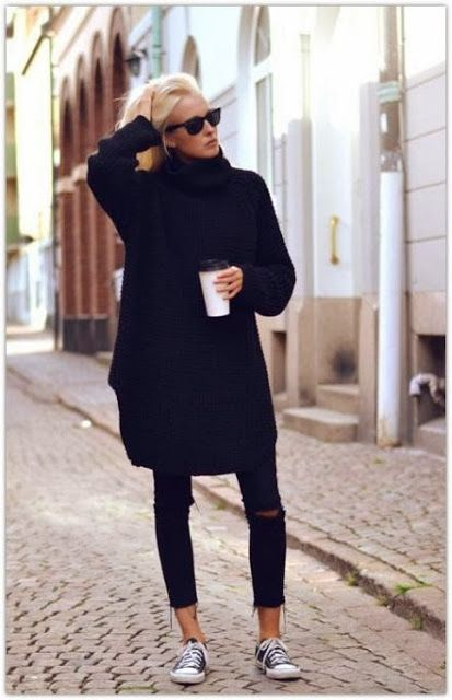 Girl wearing an oversized black knitted sweater