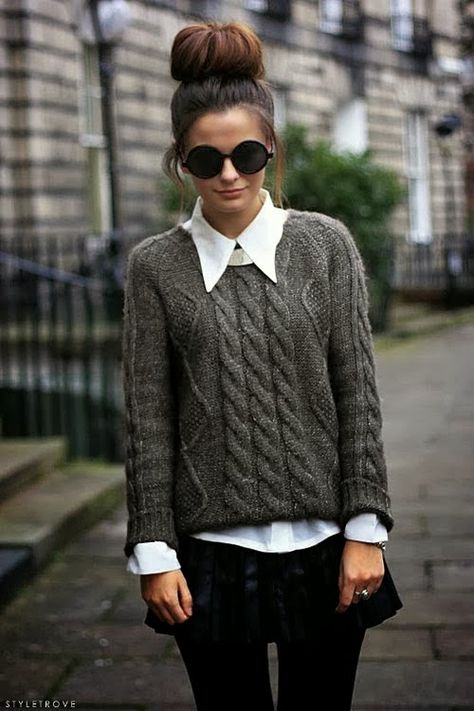 Girl wearing a grey cable knit sweater
