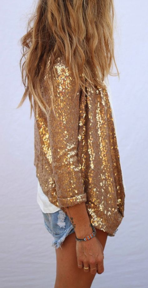 Girl wearing a sequined gold jacket