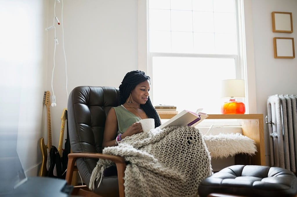 Fall activities including reading with a cosy blanket and a cup of tea