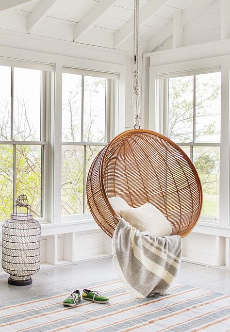 Rattan circle chair in a bright living room