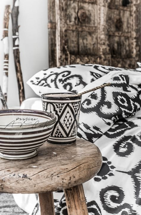 Printed textiles and dishes in black and white for fall home decor