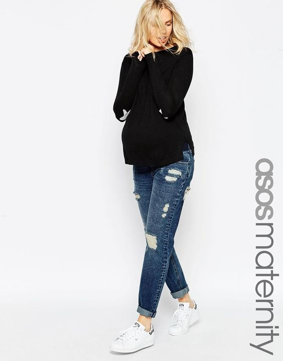 Long sleeved black top with jeans for a maternity capsule wardrobe