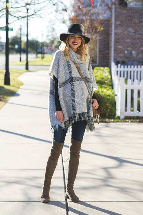 knitted poncho with fringing for a maternity capsule wardrobe
