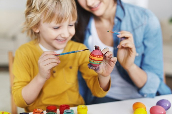 child painting and easter egg