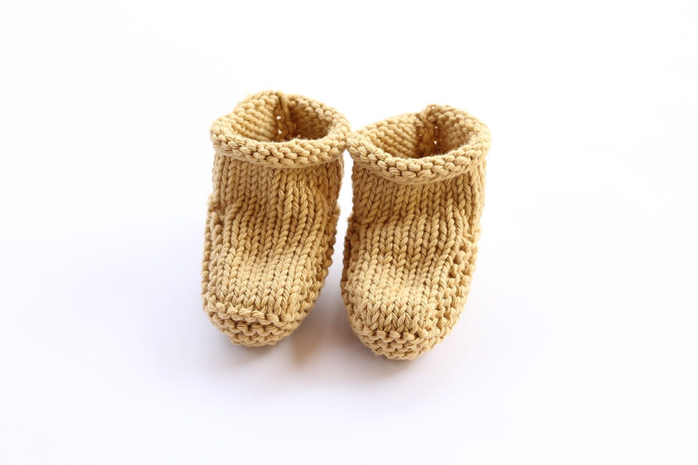 beginner baby booties knit in a mustard color