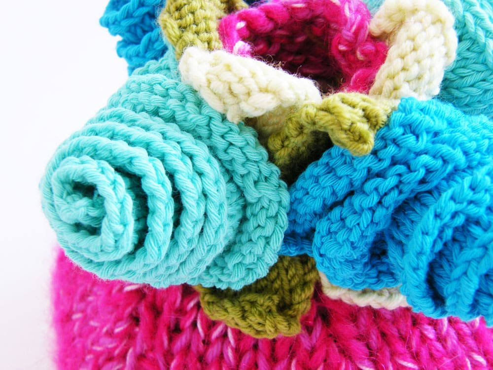 Turquoise knitted flowers