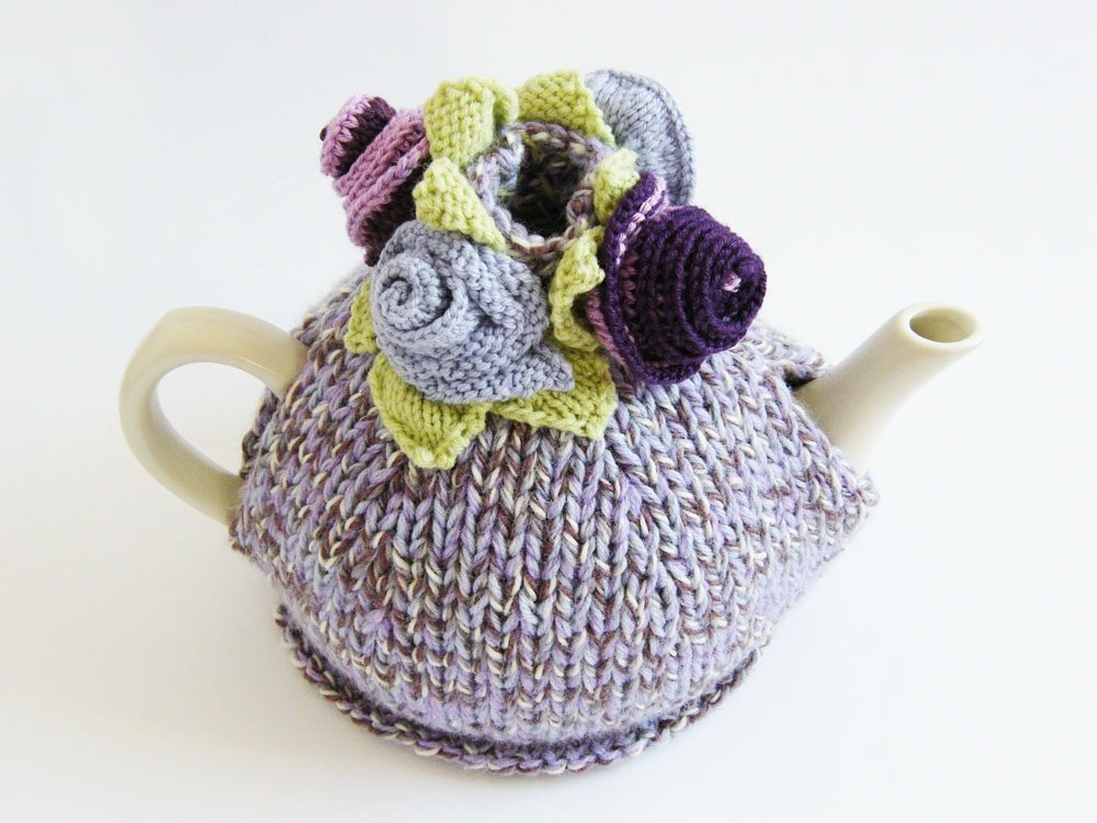 tea cosy with knitted flowers