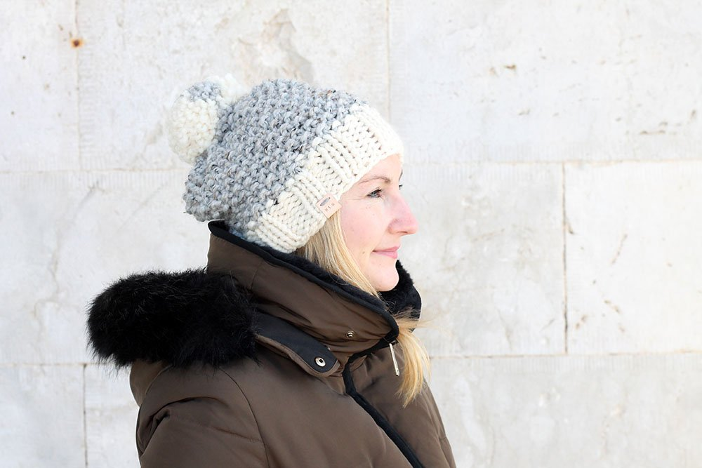 woman wearing a seed stitch knitted beanie