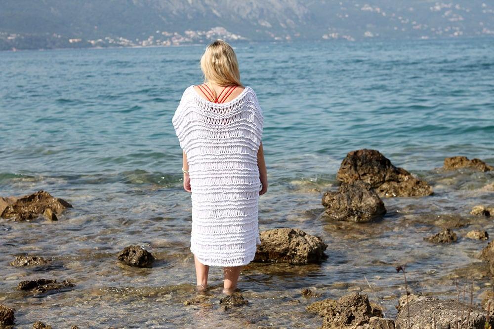 woman wearing a white knitted beach dress