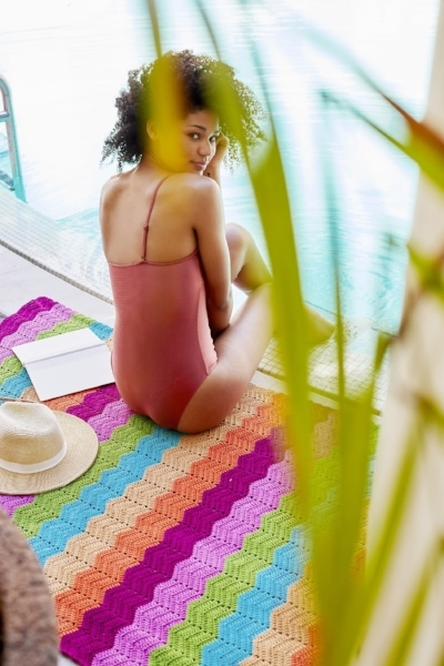 colourful crochet afghan by the pool