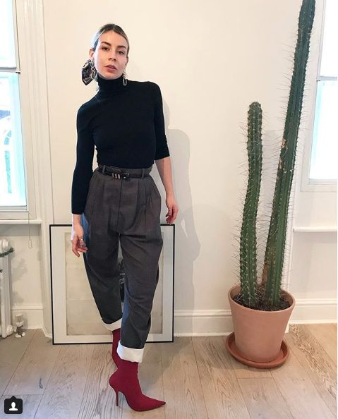 black sweater and high waist trousers outfit