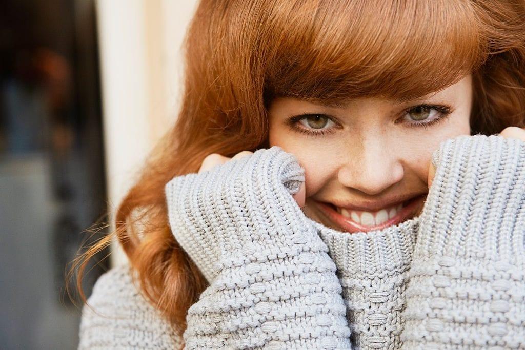 woman wearing a crochet sweater