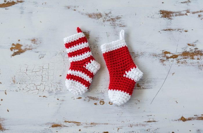 mini crochet Christmas stockings in red and white yarn