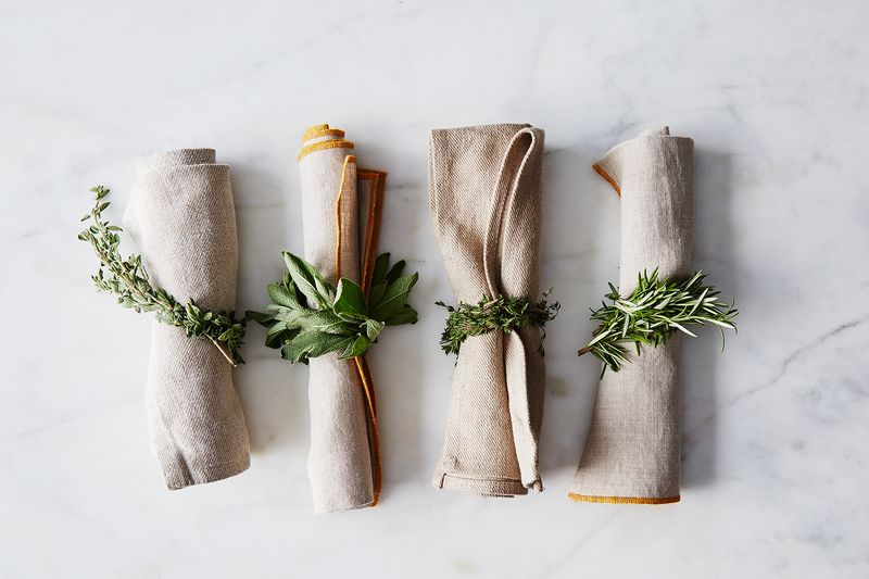 napkins tied with fresh rosemary rings