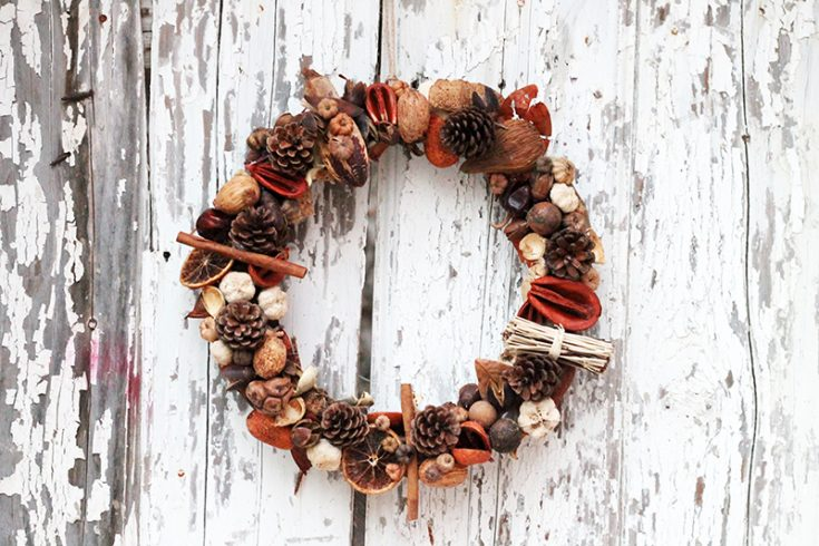 fall wreath hanging on a wooden door
