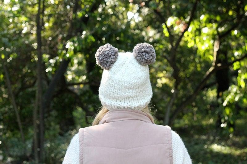 knitted double pom pom beanie