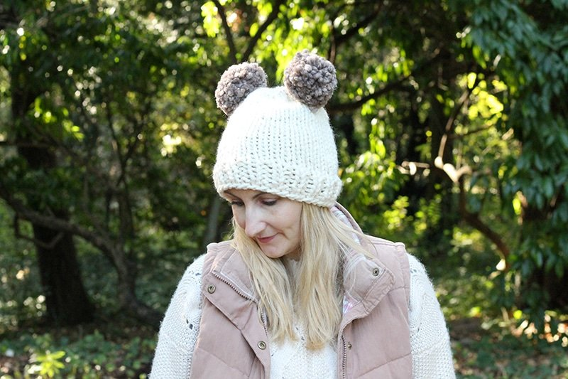 knitted hat with two pom poms