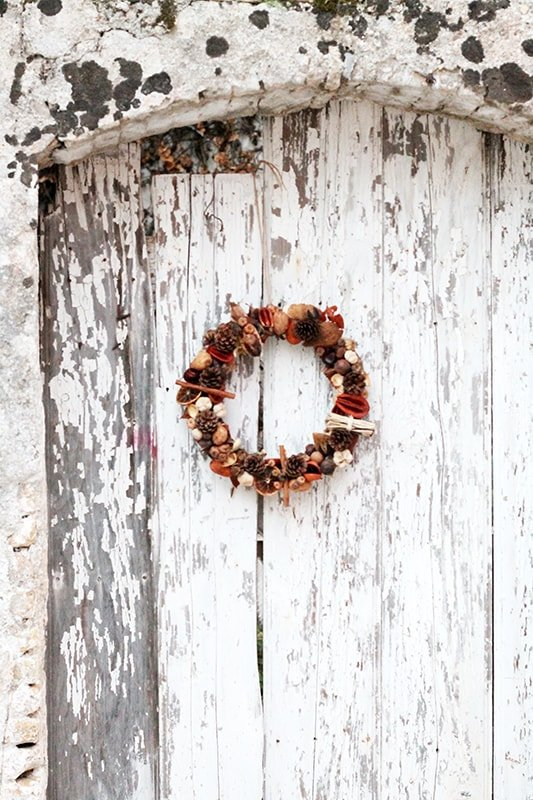 festive autumn door wreath made with dried flowers
