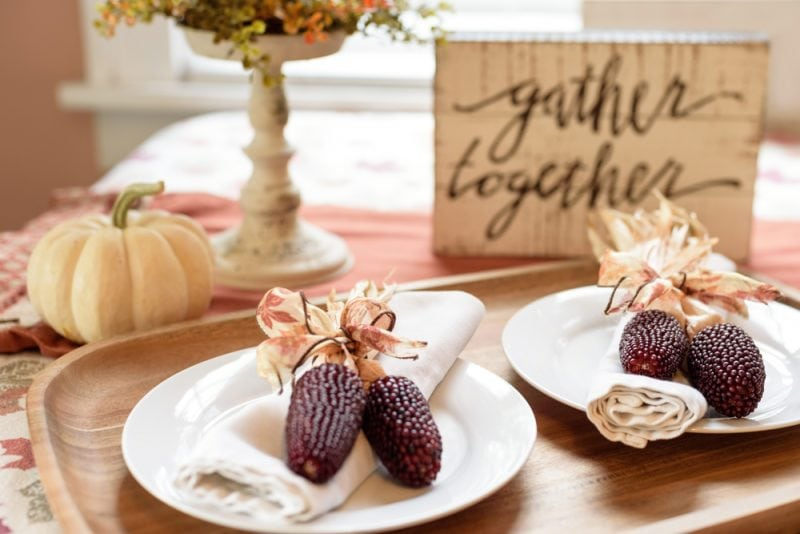 Thanksgiving table decor with pumpkins and corn decorations