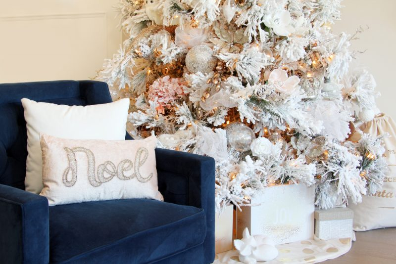 living room with white and silver Christmas tree