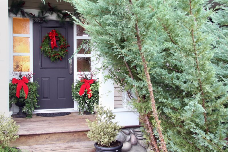 Christmas front door wreath with red ribbon