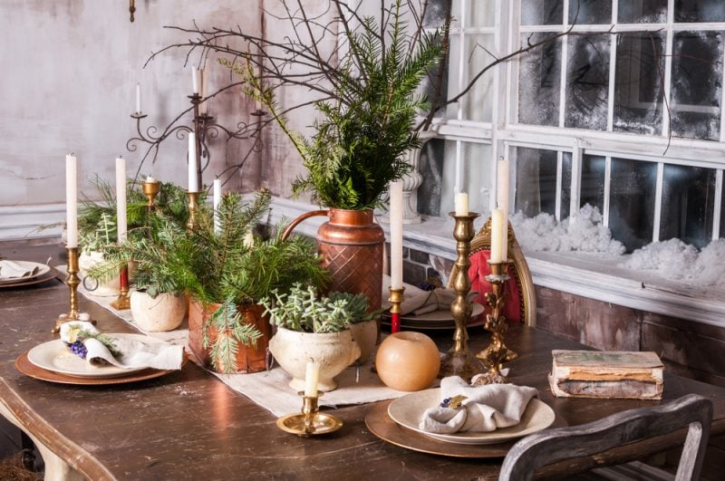 Christmas dining table with greenery tablescape