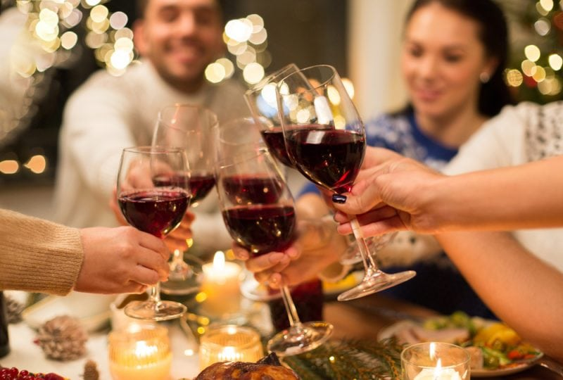 Christmas dining table with wine and guests