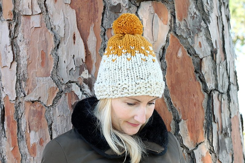 woman wearing a two colour knit hat