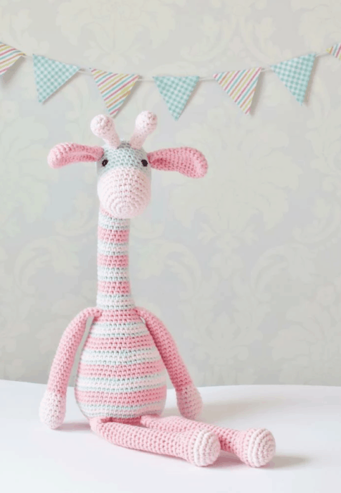 pink and white striped crochet giraffe