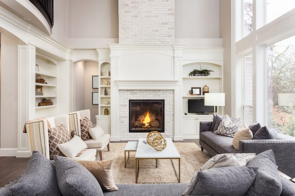 Cozy living room with white walls and open fireplace
