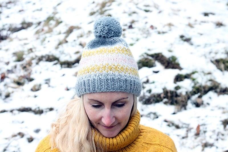 woman wearing a fair isle knit beanie with pom pom