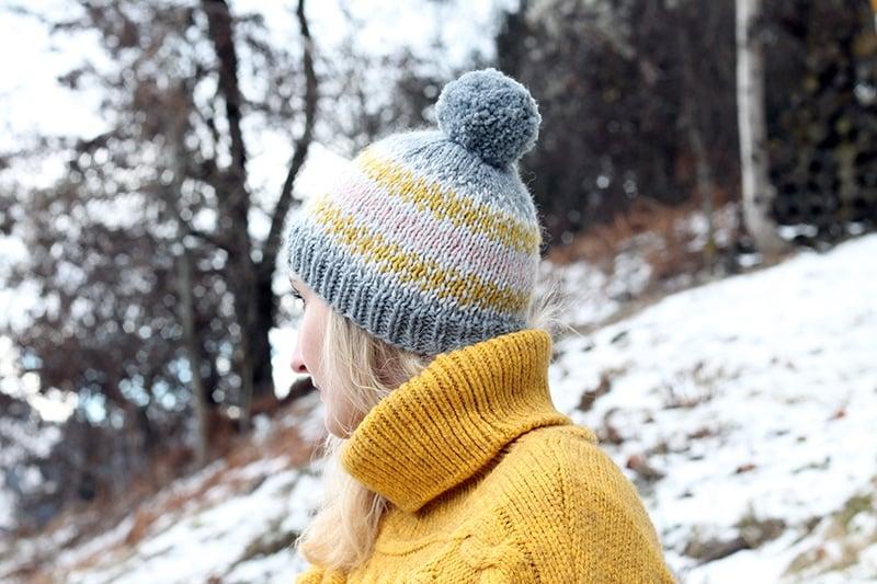 woman wearing a fair isle knit bobble hat