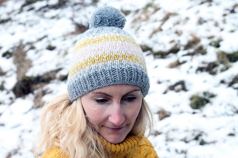 woman wearing a fair isle knit beanie hat