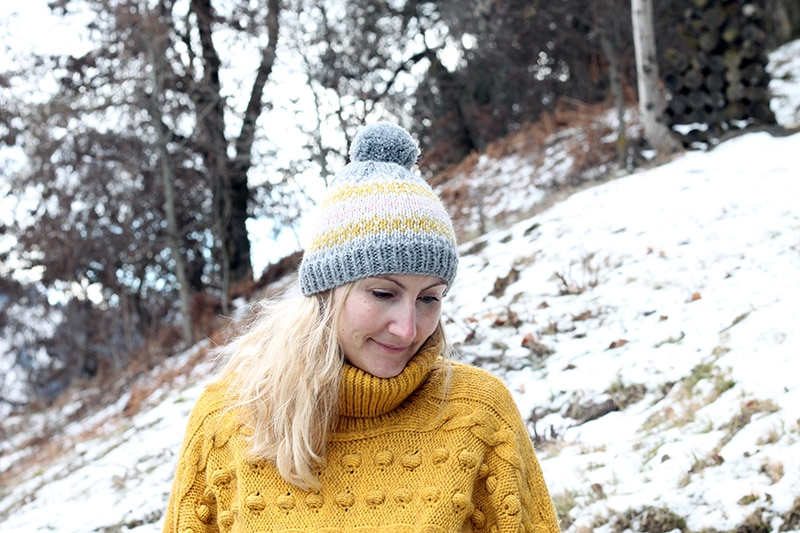 woman wearing a fair isel knit hat in four colours