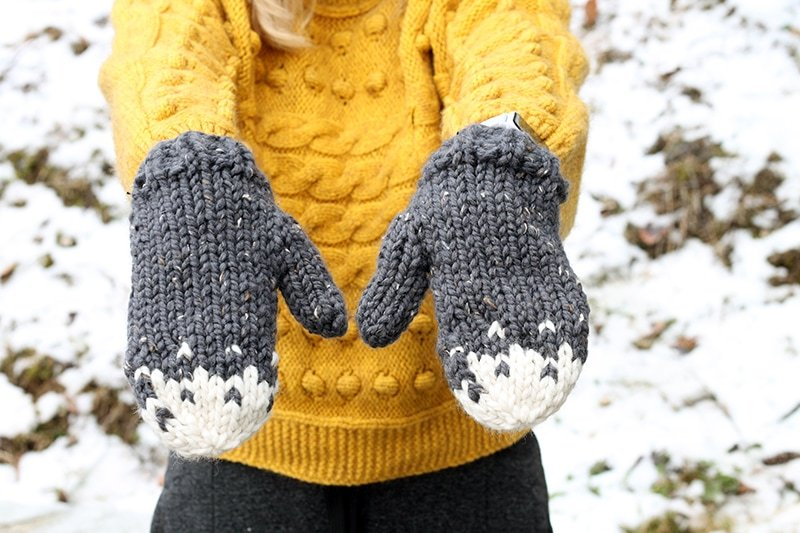 snow tipped knitted mittens