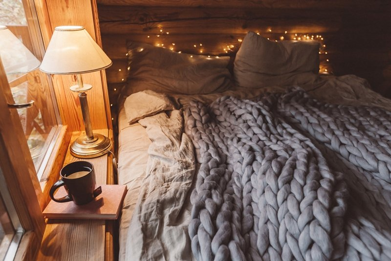 Cozy cabin bedroom knitted blankets