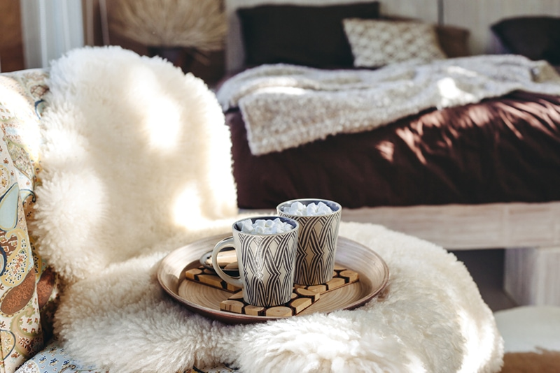 seat with fur throw and tray with hot chocolate