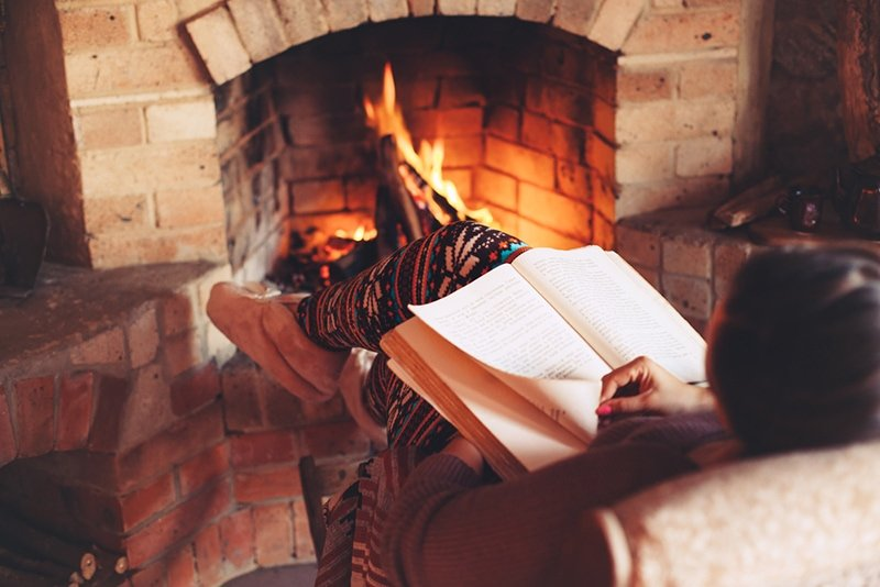 Cozy log cabin bedroom fire reading