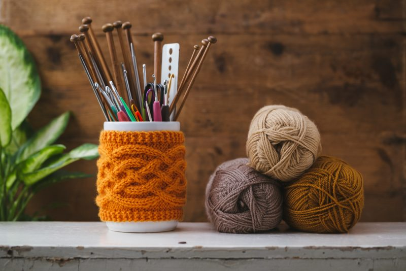 knitting needles and hooks in a jar