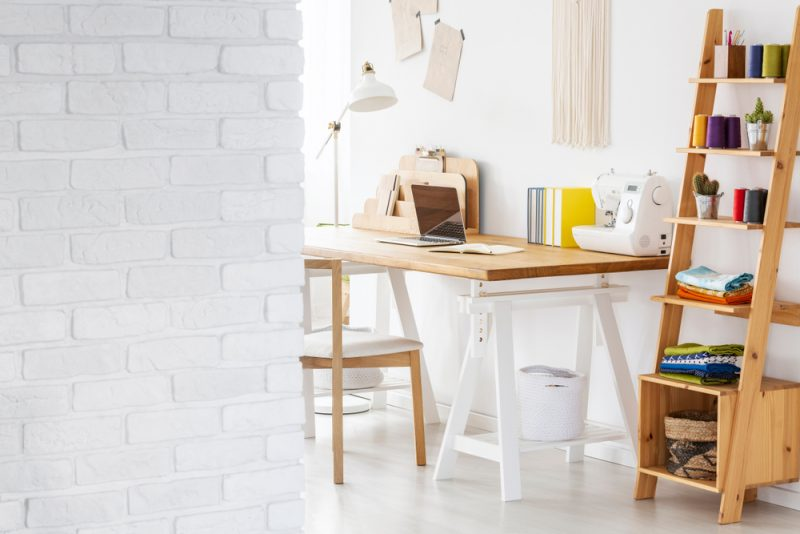 craft workspace with desk and sewing supplies